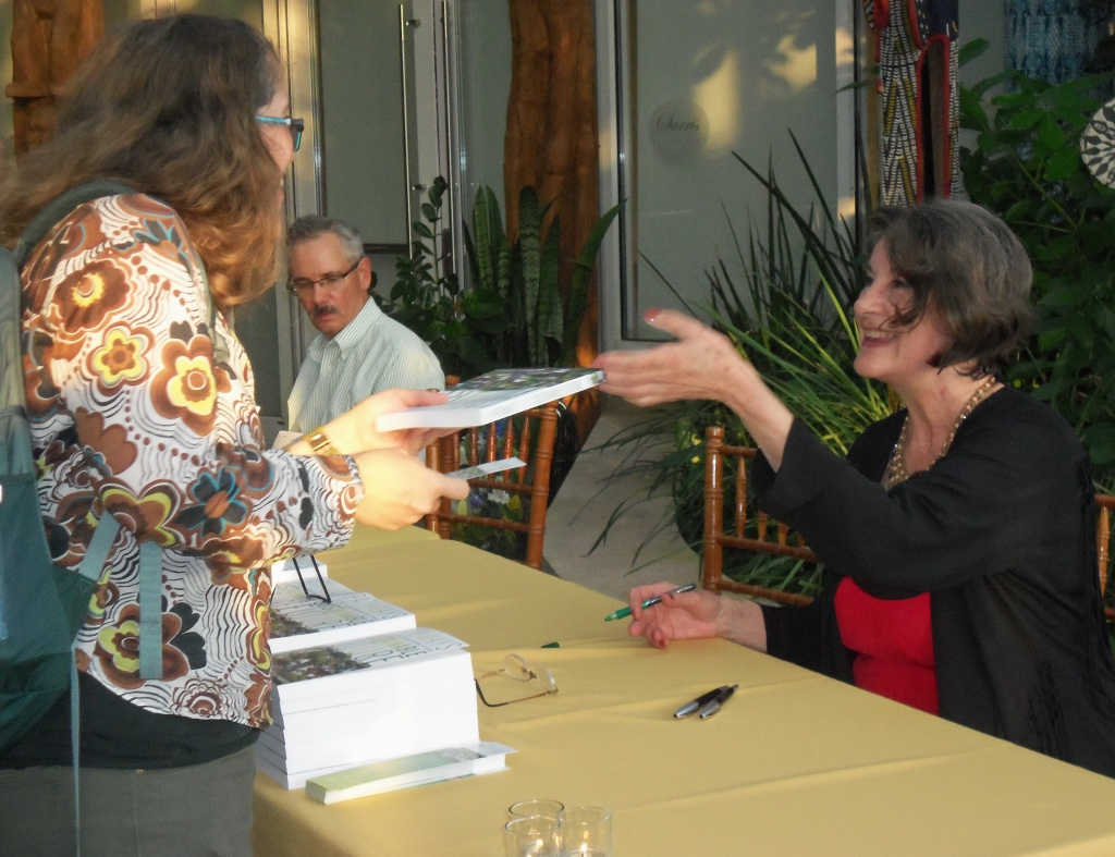 Patty DeMarco signing her new book.
